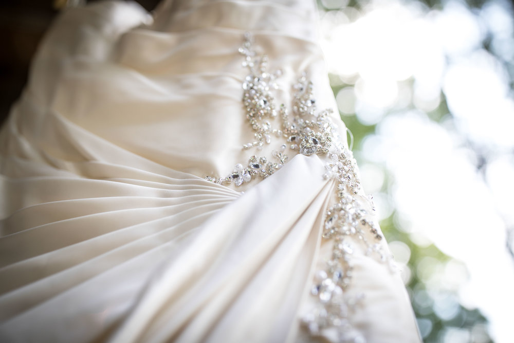 The white wedding dress hung to show close up detail