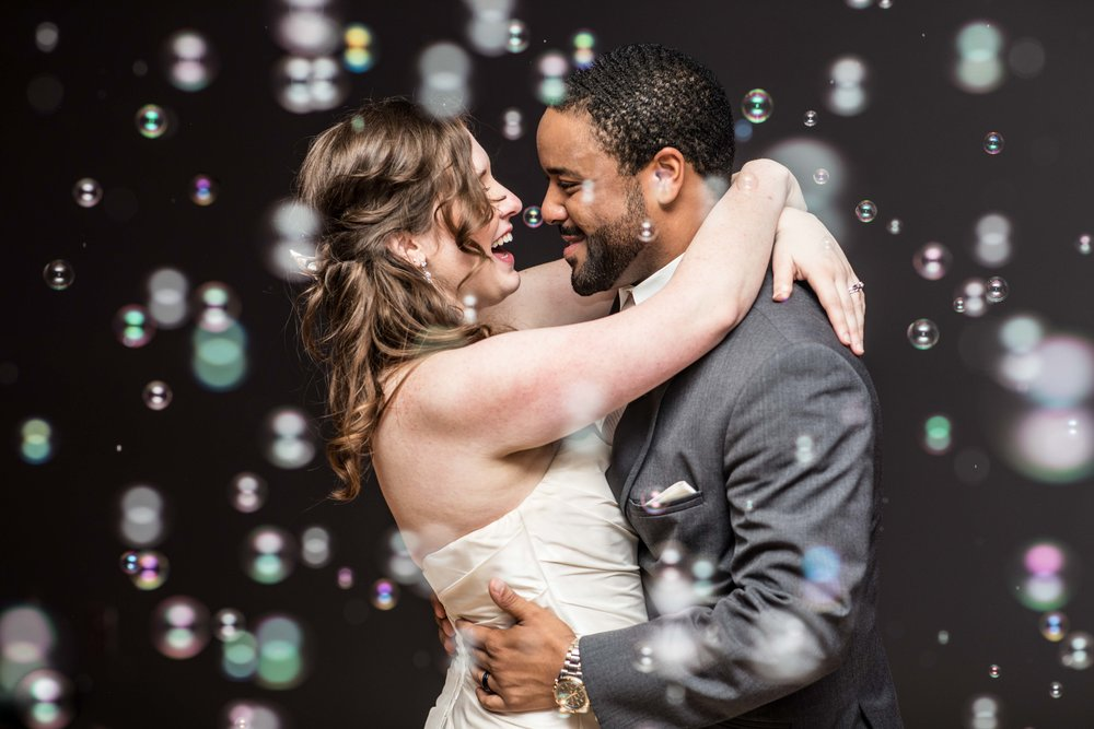 Bubbles fill the dance floor while the bride and groom have their first dance