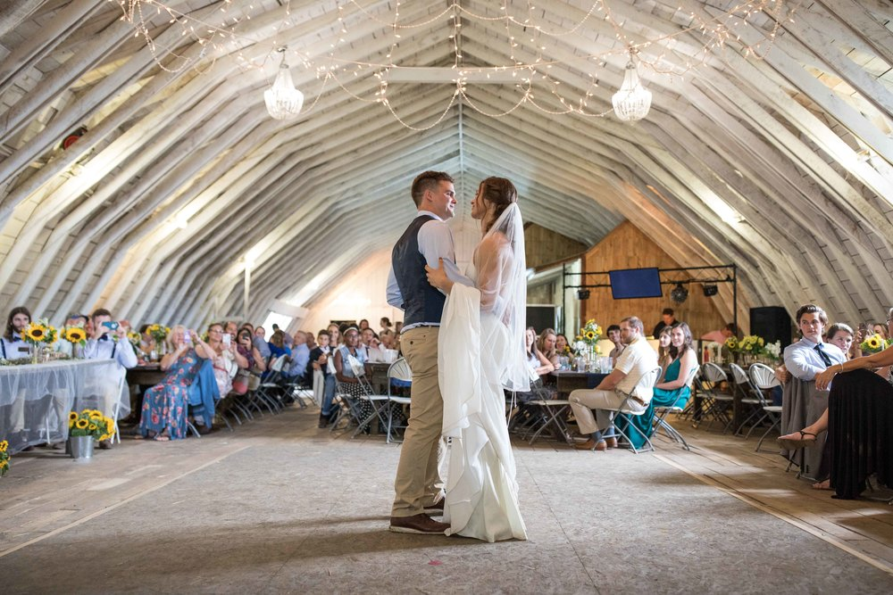 the first dance as husband and wife in the loft of a real working hay barn