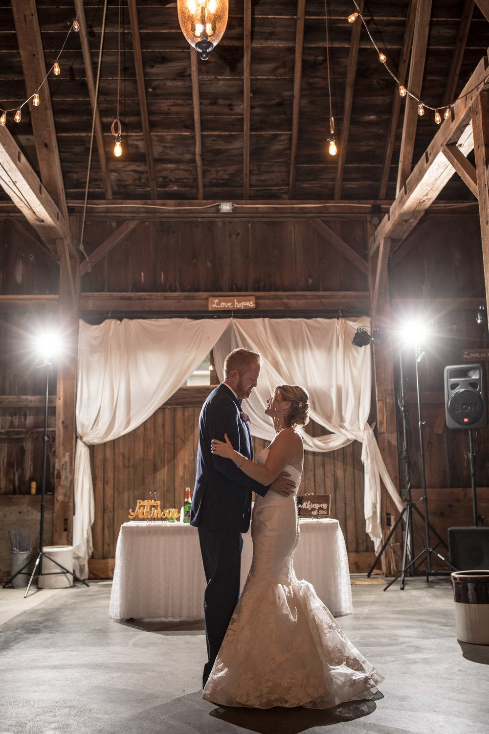 First dance as husband and wife with off camera flashes in the background