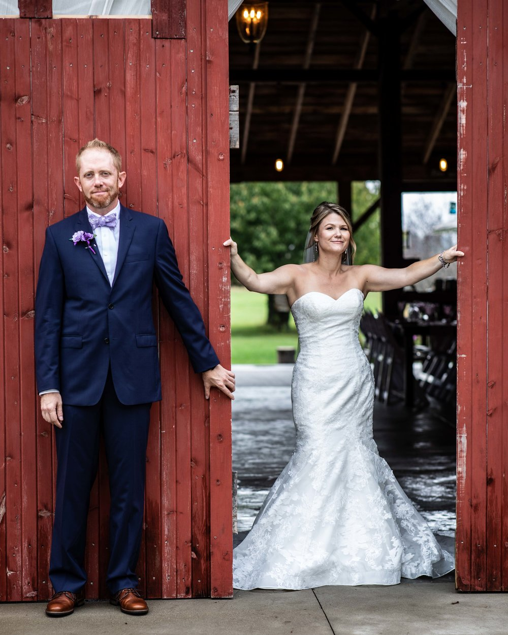 The Bride and Groom's hidden first look with the bride in the barn and groom just outside