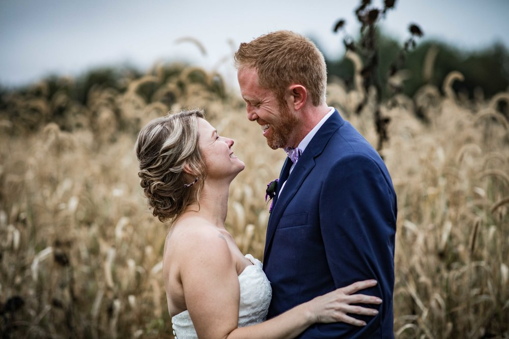 bride and groom portrait in front of a golden autumn field