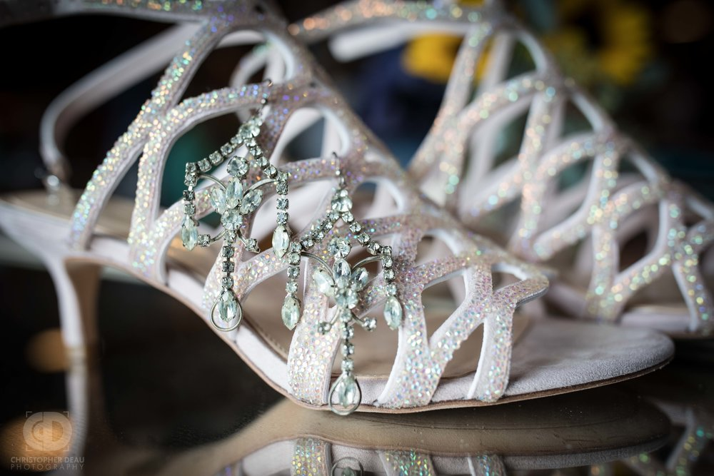 The brides shoes with antique earrings