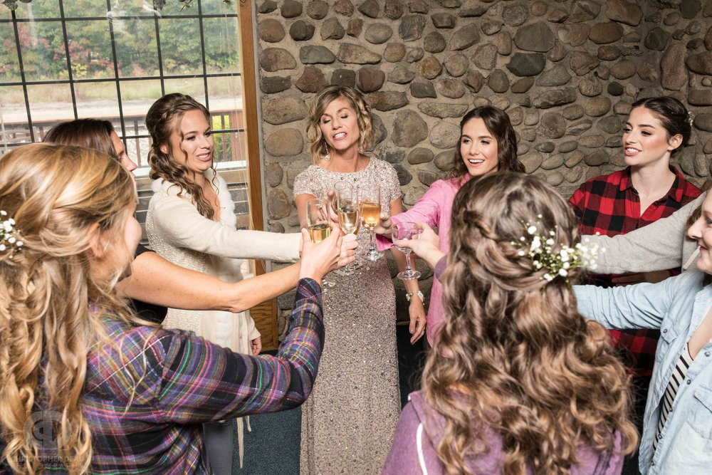 The bridesmaids share a champagne toast