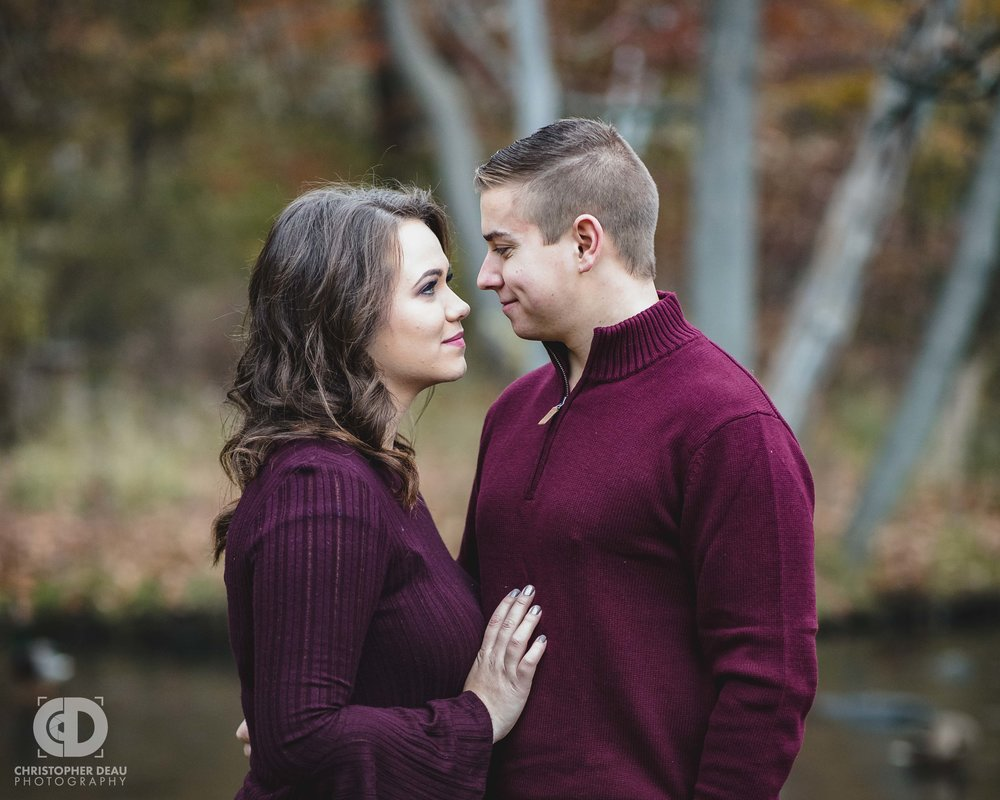 Couple looks at each other with stream and ducks in the southwest Michigan background