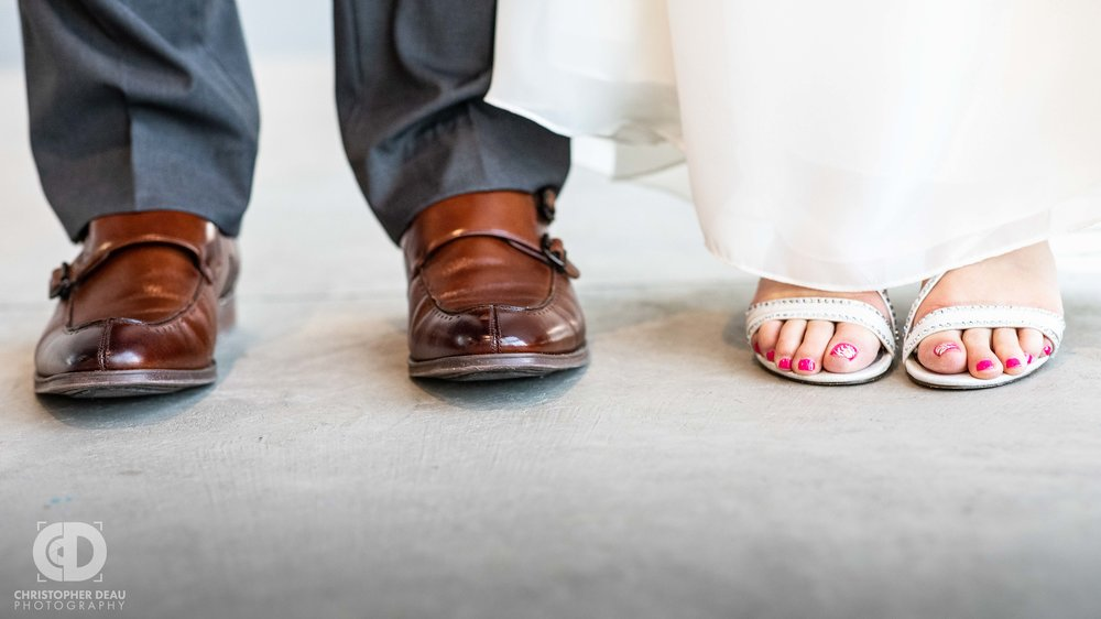 his and her shoes at their wedding