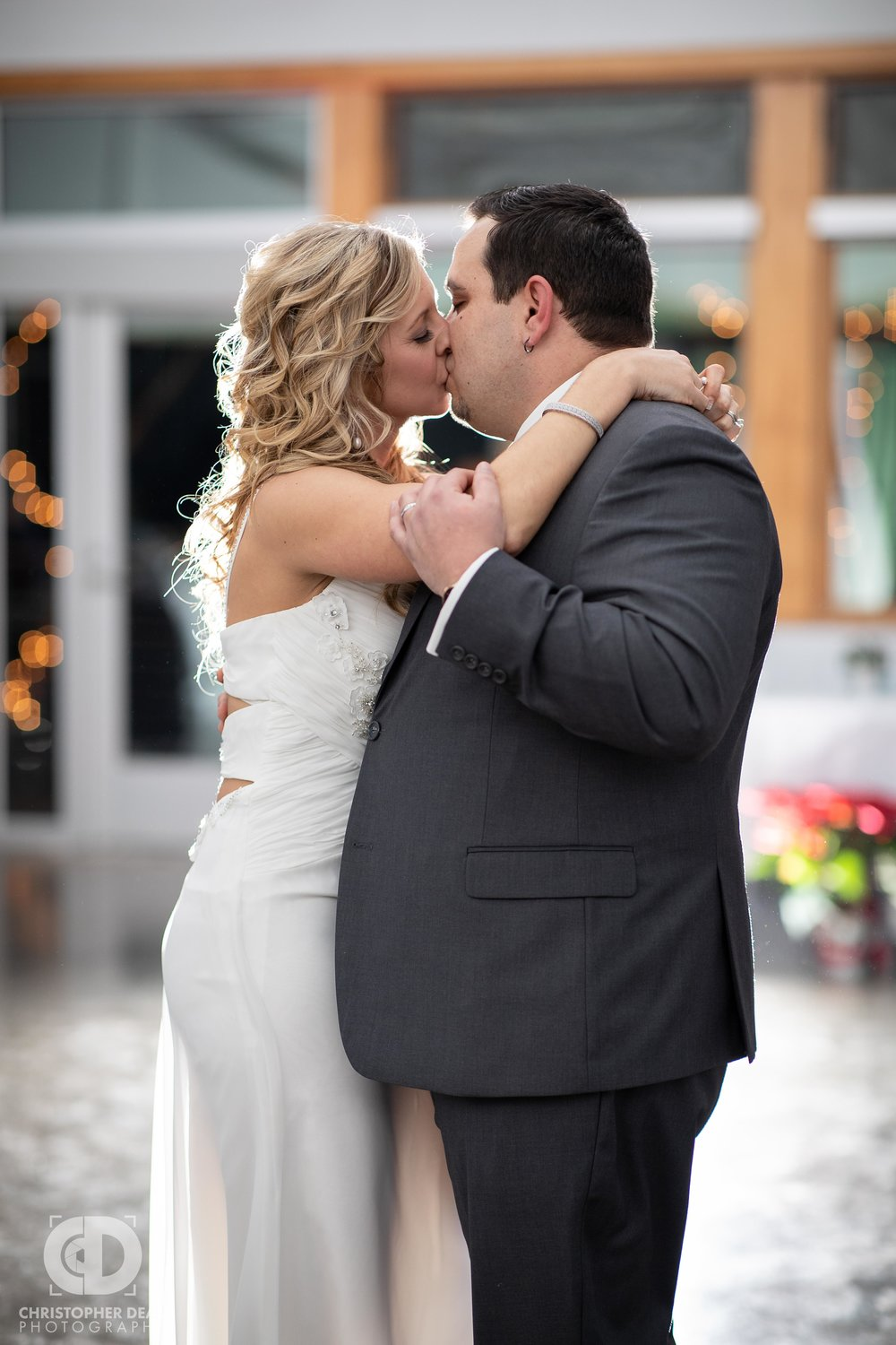 Bride and Groom share a kiss during their first dance at the Girl Scouts building in Kalamazoo at their wedding reception