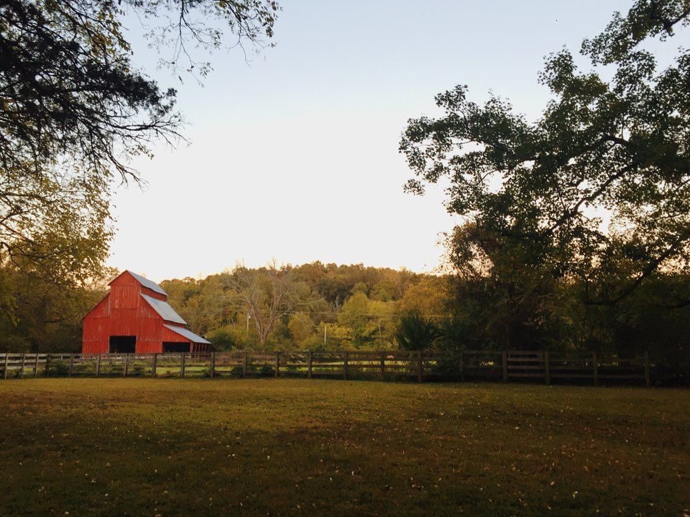 The prettiest barn that sits right above the waterfall.