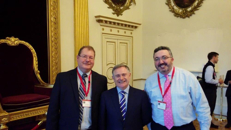 OpenDataSoft Employees Ian Henshaw (left) and Jason Hare (right) meet with Irish Reform Minister Brendan Howlin (center) at Dublin Castle in 2014 in support of the Irish commitment to the Open Government Partnership.
