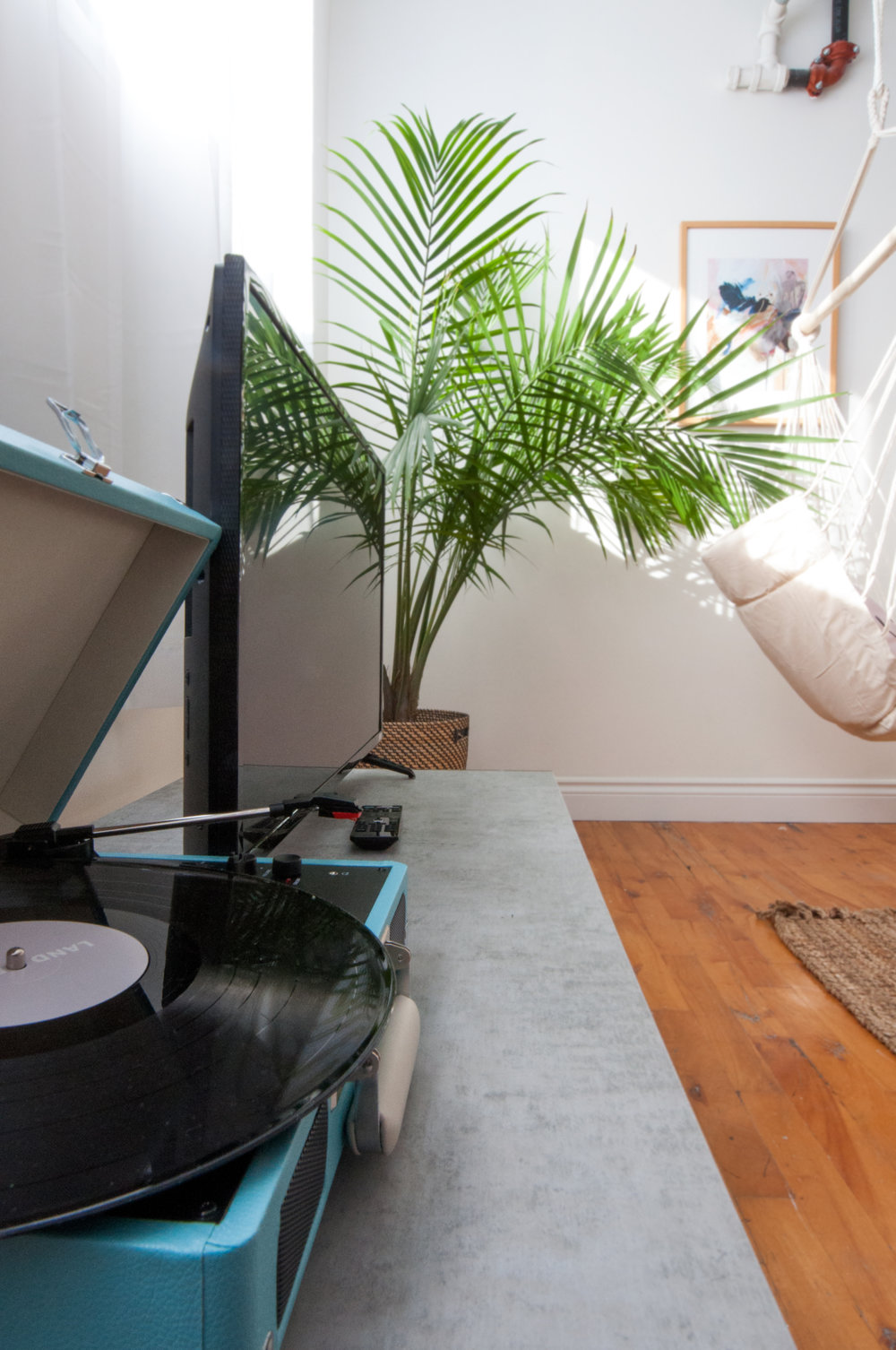 A portable set of speakers: keep the good times rolling - Whatever space your guests choose to chill out in the music can follow.  Add pieces like a bluetooth speaker or a record player complete with records by local bands.