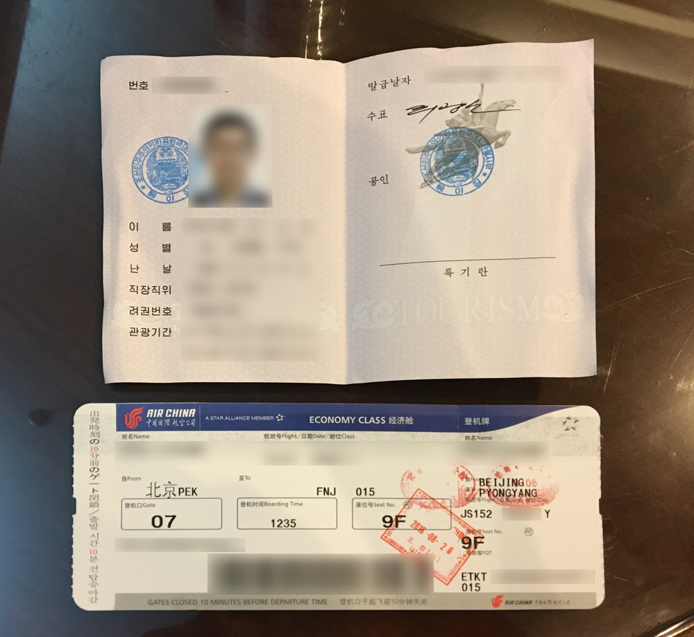 DPRK tourist visa card and Air Koryo boarding pass