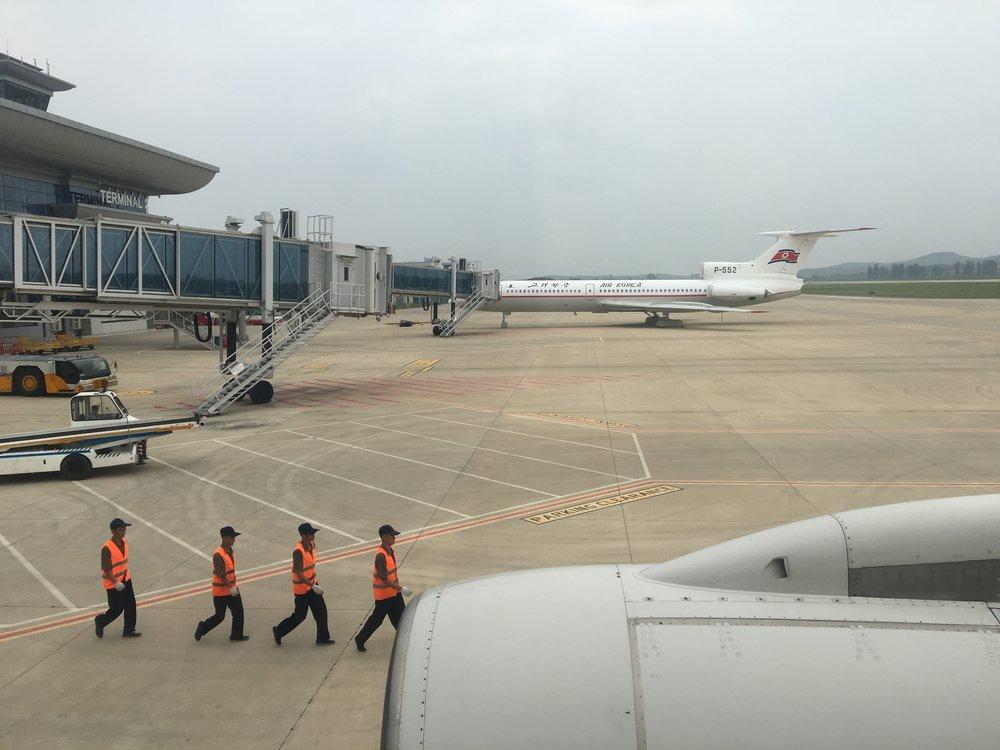 Ground crew at the Pyongyang Sunan International Airport