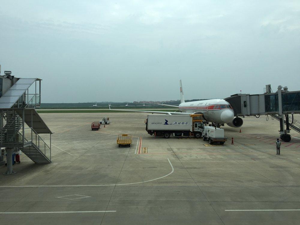 Air Koryo TU204 parked at the gate of Pyongyang Sunan International Airport