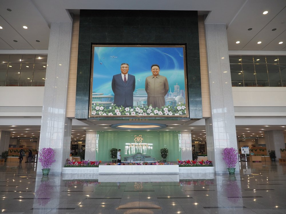 The great leaders watch over everything, including the entrance to this complex.