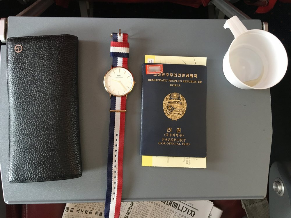 A North Korean student's Daniel Wellington watch and passport