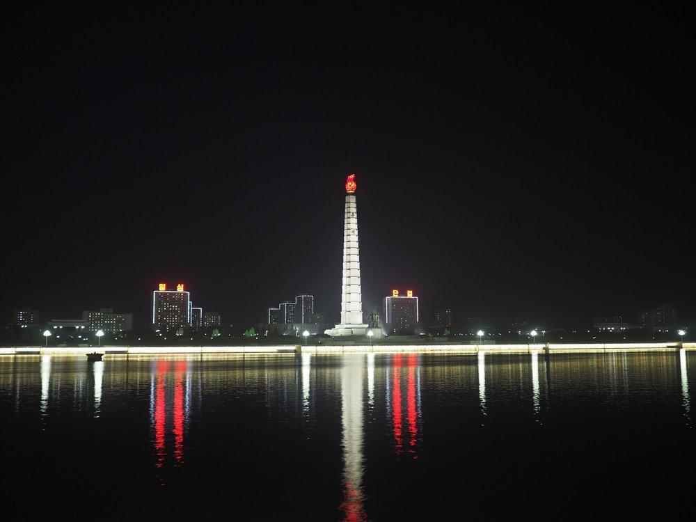 The Juche Tower at night