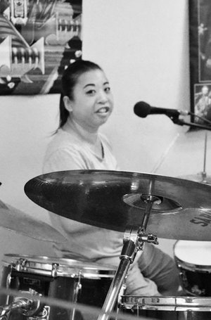 Pam Pam is the drummer and backup vocalist in Southside Ensemble. She is inspired by many types of music, but one of her favorite drummers of all time is Ryan Sullivan from Survivor. When Pam is not drumming you can find her in the recycling center at Southside!