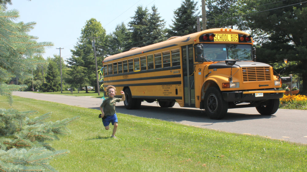 "In this 2011 photo provided by Mark Barden, his son Daniel Barden runs alongside a school bus in Newtown, Conn. Daniel was among those killed during the Sandy Hook Elementary School shootings on Dec. 14, 2012, in Newtown. Mark Barden is one of the subjects in the documentary ""Newtown."" Photo Provided"