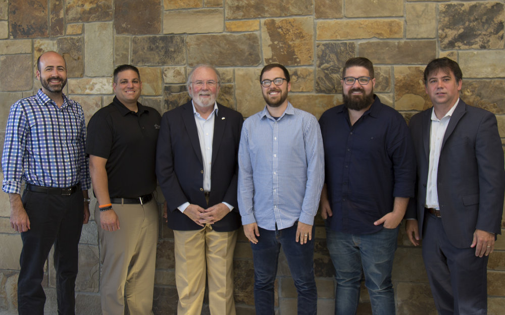 The Ark Applications team with Script founders Aaron White,Patrick Cahill, and John Legg.