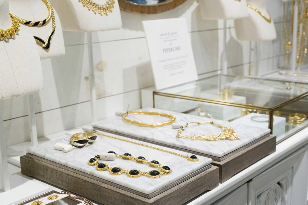 Marble displays & delicate glass cabinets were designed and placed throughout the store, mainly featuring our key jewelry accessories.
