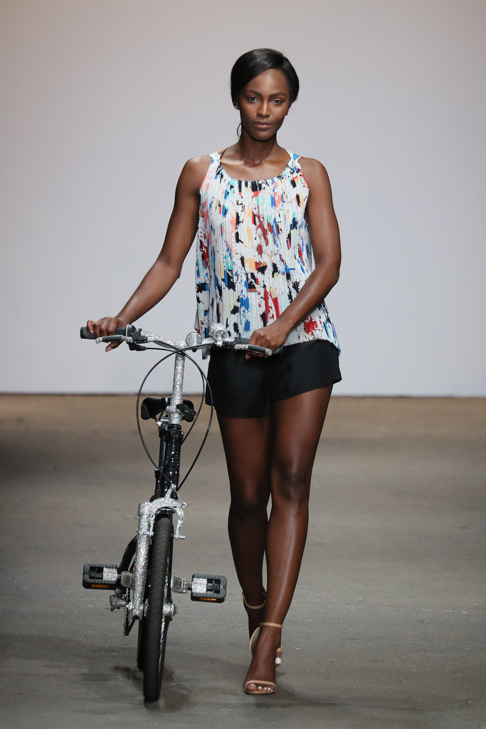 America's Next Top Model, Mame Adjei, opens the show with Jimmy Crystal's $40k bike, adorned with over 50,000 Swarovski crystals and took over a month to produce.