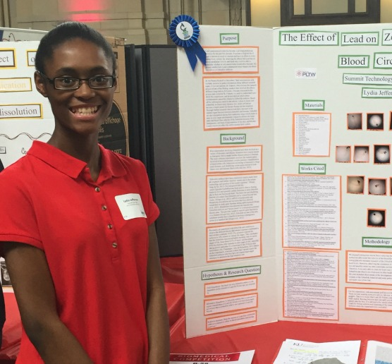 Lydia Jefferson with her project, which was inspired by the Flint, Mich., water crisis.