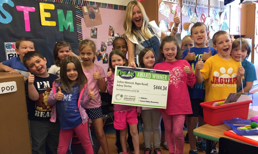 Regan Russell of Sunset Valley Elementary and her students are surprised by the PEAK Patrol.