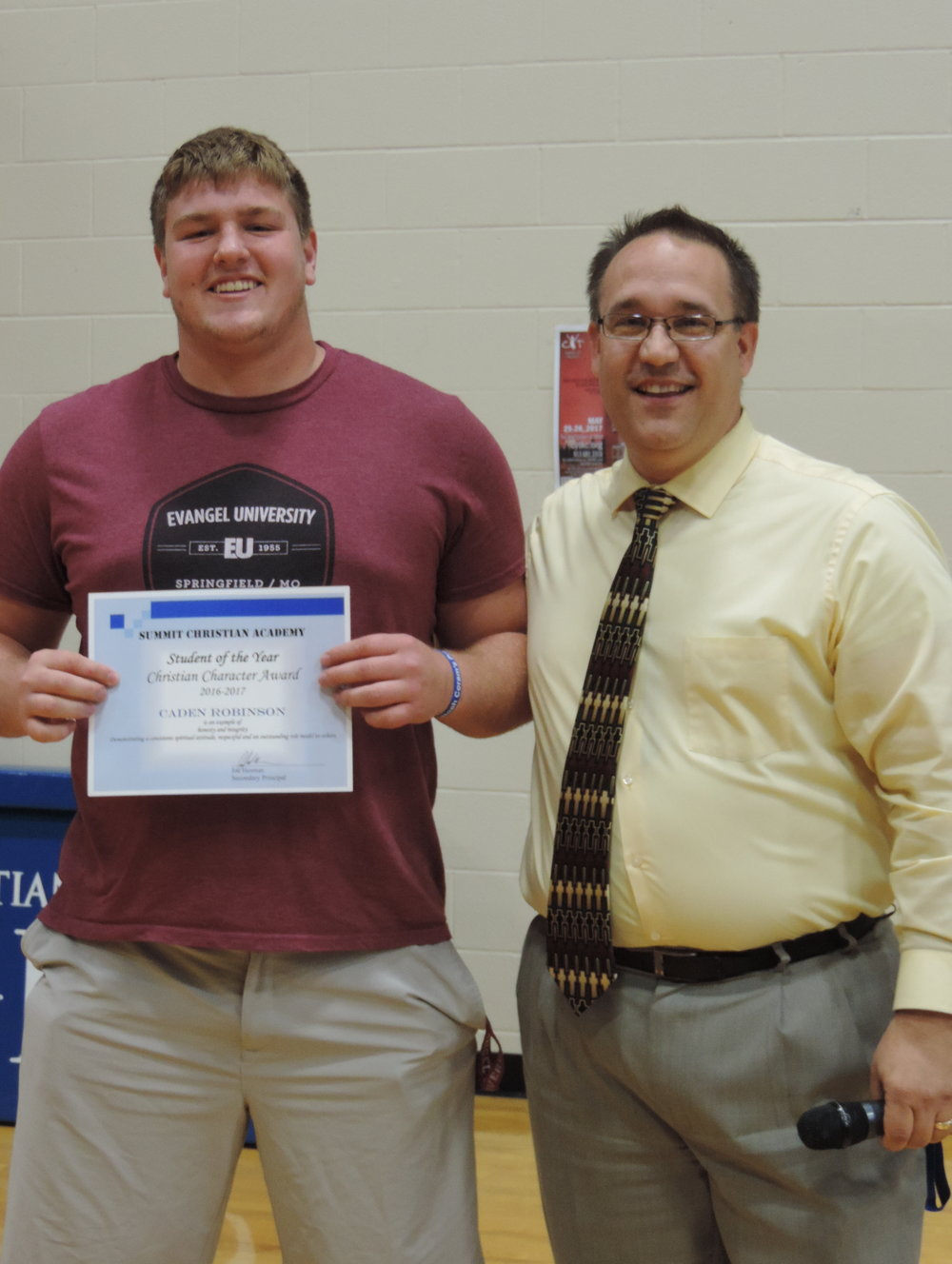 2017 Christian Character Student of the Year Senior Caden Robinson with SCA Secondary Principal Mr. Joe Hesman.