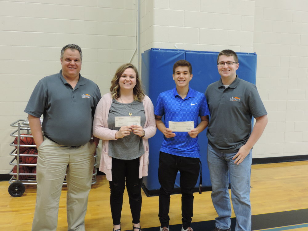 Integrity owner David Todd (left), along with Integrity employee and SCA Alumni Taylor Shippy (far right), presented SCA Seniors Lindsey Berry and Abram Bagunu with the annual $1,000 Integrity Scholarship during SCA's annual awards assembly.