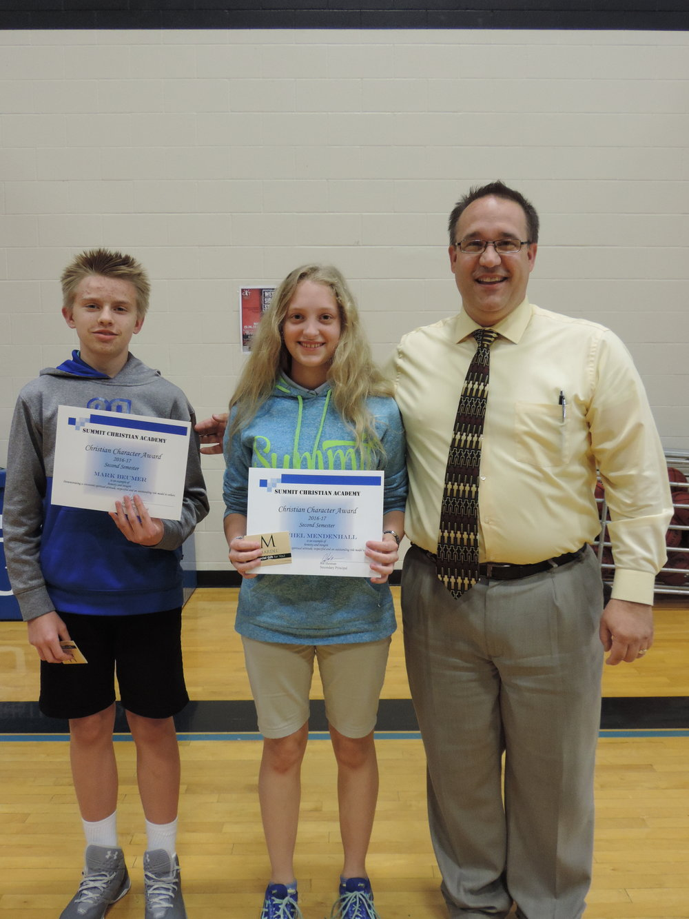 SCA seventh grade students Mark Beumer and Rachel Mendenhall, pictured with SCA Secondary Principal Joe Hesman, received the Christian Character Award for second semester.
