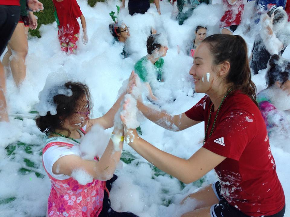 "SCA Senior Rayna Cross enjoys the Bubbles in the ""Messy War"" with her camper buddy at Camp Blessing."