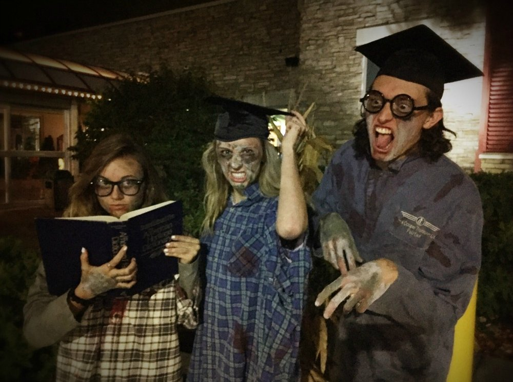 """LSNHS """"zombies"""" raising money for good causes are (from left) Alexis Becker, Caitlin Brown and Cameron Riffle, all seniors at Lee's Summit North High School and members of National Honor Society."""
