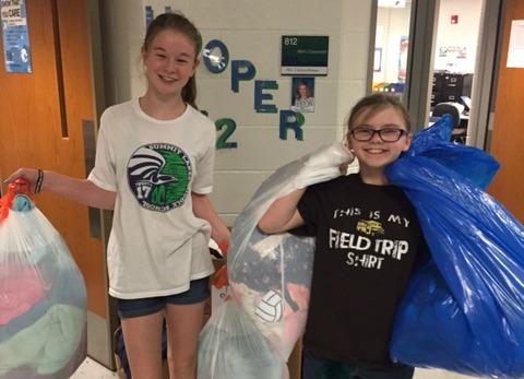 Sarah Alton and Jordan Crawford help collect clothing.