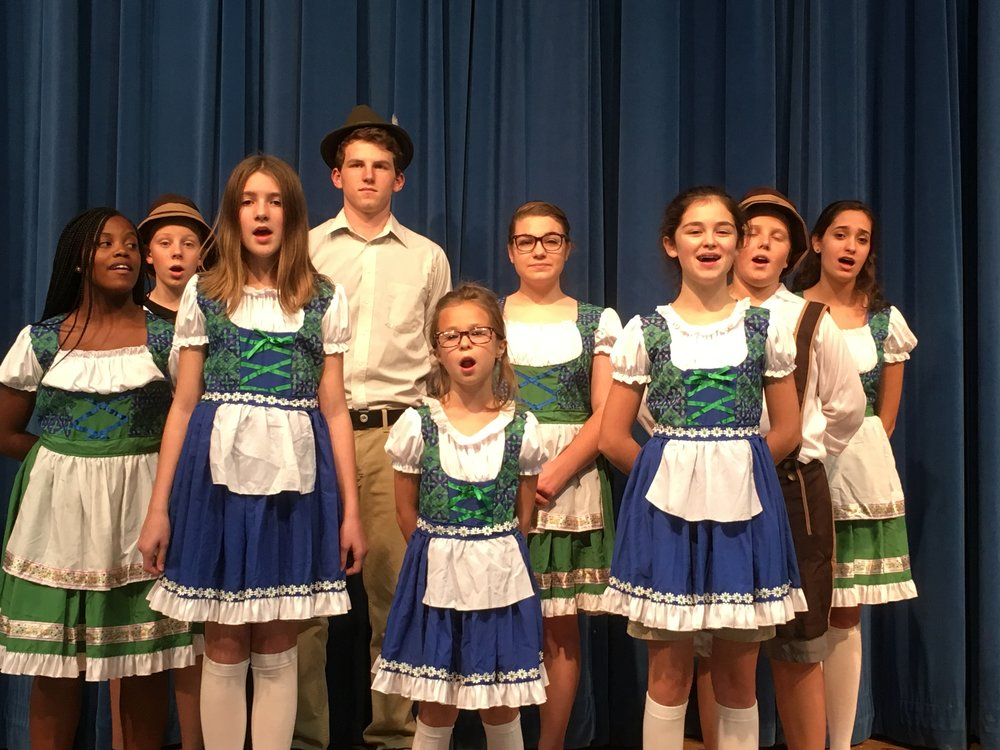 SCA Senior Madelyn Mahurin plays Maria Rainer (pictured center) with the von Trapp Family pictured left to right front row Brigitta played by Shea Rider, Gretl Played by Chloe Mankin, and Marta played by Keyler Quessenberry. Next row: Louisa played by M'racle Bryant-Morgan, Friedrich played by Hunter Harris, Captain Georg von Trapp played by Patrick Simpson, Maria played by Madelyn Mahurin, Kurt played by Hudson Harris and Liesl played by Faith Mendenhall.