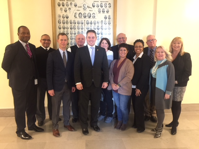Pictured with Rep. Elijah Haahr (center) are (front row, from left) Mark Van Blaricum, Mia Fulson, Cita Trice, Jackie Clark, (back row, from left) Dr. Dennis Carpenter, Stephen Hill, Dennis Smith, Elaine Bluml, Mike Johnson, Rick McDowell and Phyllis Balagna.