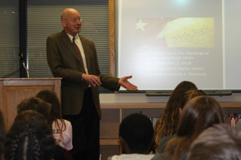 Judge Charles McKenzie shares information with the eighth-graders.