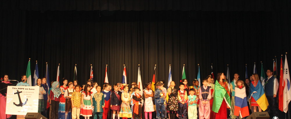 The Parade of Flags begins the International Festival with a word of prayer at SCA'ssixth International Festival.