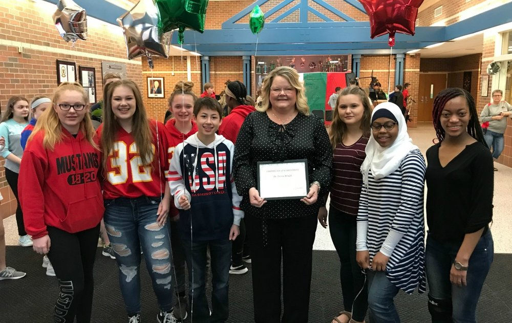Campbell students participating in the school's WEB leader program celebrate Dr. Wright's regional award with her at the school.