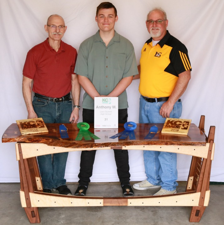 Anthony Mixon won top honors with his Hawaiian Koa desk with the assistance of retired Lee's Summit R-7 teacher and administrator Jay Helland. Anthony is pictured with Mr. Helland (left) and Mr. Mixon.