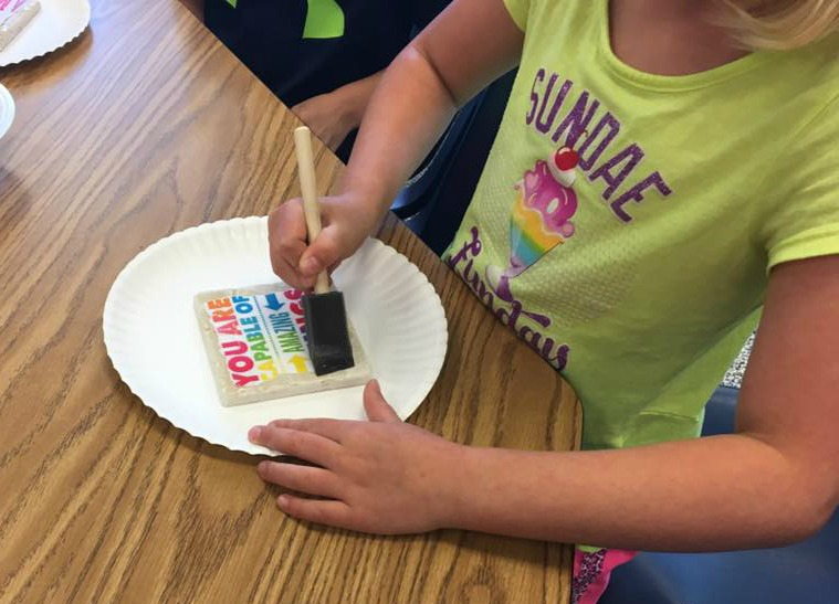 Kindergarten students create coasters.