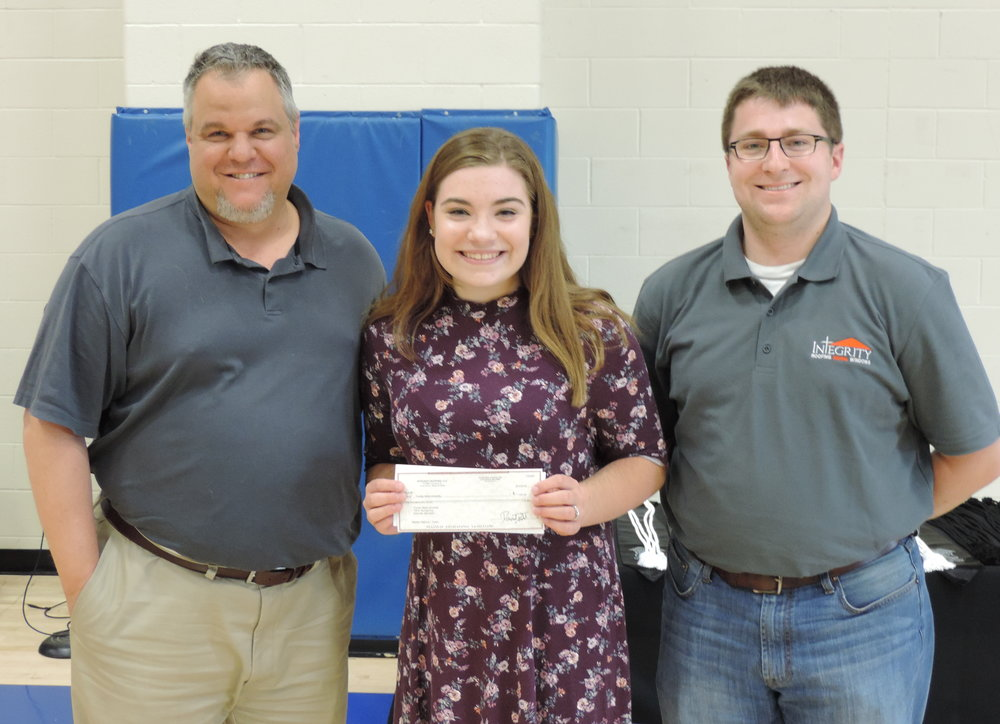 (from left to right) Integrity owner David Todd, SCA Senior Madelyn Mahurin, and SCA Integrity employee and SCA Alumni Taylor Shippy at SCA's Award Assembly where Mahurin won the annual $1,000 Integrity Scholarship.