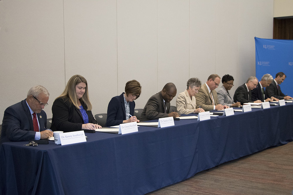 Pictured at the signing are (from left) Dr. Kenny Southwick, interim superintendent, Shawnee Mission School District; Dr. Cheryl Reichert, director, Raytown Quality Schools; Dr. Jessica Dain, assistant superintendent, Olathe Public Schools; Dr. Dennis L. Carpenter, superintendent, Lee's Summit R-7 School District; Dr Cynthia Lane, superintendent, Kansas City Kansas Public Schools; Dr. Todd White, superintendent, Blue Valley Schools; Dr. Kimberly Beatty, chancellor, Metropolitan Community College; Dr. Greg Mosier, president, Kansas City Kansas Community College; Dr. Joe Sopcich, president, Johnson County Community College; and Dr. David Cook, vice chancellor, University of Kansas Edwards Campus. — Photo by Lindy Rhodes