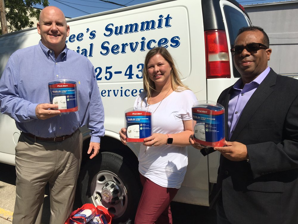 Tom Pruett, left, and Jason Lassiter, CEO and founder of Safety52, dropped by dozens of carbon monoxide detectors to Lee's Summit Social Services recently.