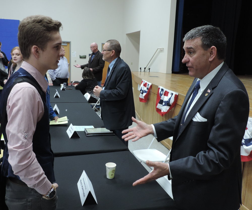 SCA Junior Brandon Self had the opportunity to visit with Representative Mike Haffner at Summit Christian Academy's second annual Legislative Breakfast.  (Photo courtesy SCA)