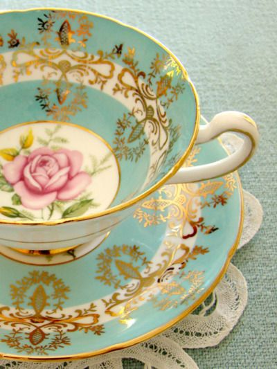 Bright blues, pinks and corals all encompassed in one delicate, elegant piece of china.