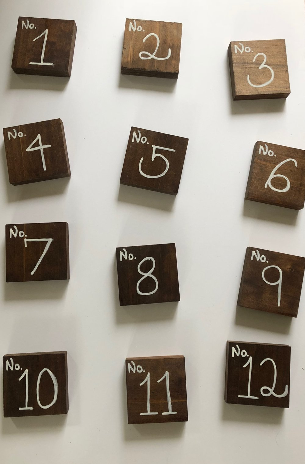 Hand-lettered, wood-block table numbers - (#'s 1-12)