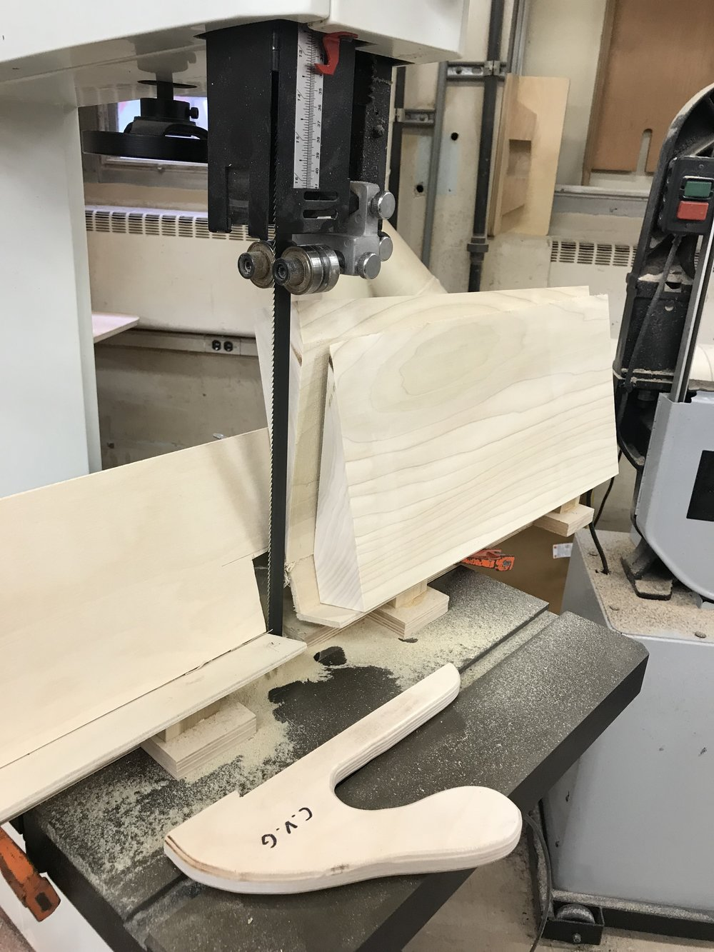 Making the slanted cut on the band saw on the jig that I made