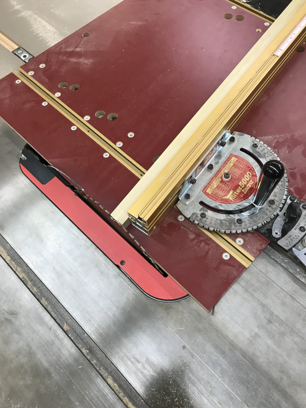 Using the miter gage to cut slanted legs to match floor