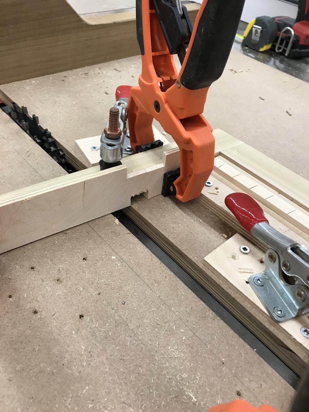 After a first pass, I shift the piece over like in the photo above to finish the cut at my final width. The orange clamps keep a backing to the cut, minimizing tear-out on my pieces as the blade exits.