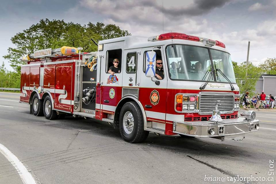 Pumper Tanker 4 taking part in the 2015 Apple Blossom Festival Parade in Kentville.